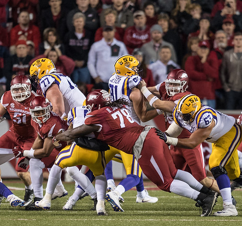 Arkansas Razorbacks defensive lineman Bijhon Jackson (78) tackles LSU Tigers running back Derrius Guice (5) during a football game between Arkansas and LSU on Saturday, November 12, 2016.  (Alan Jamison, Nate Allen Sports Service)