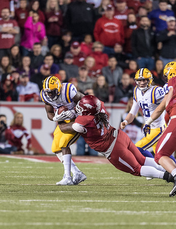 Arkansas Razorbacks defensive lineman Bijhon Jackson (78) tackles LSU Tigers running back Leonard Fournette (7) during a football game between Arkansas and LSU on Saturday, November 12, 2016.  (Alan Jamison, Nate Allen Sports Service)