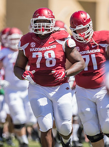 Bijhon Jackson runs onto the field before the Arkansas Razorback Spring Football Game on 4/23/2016.   (Alan Jamison, Nate Allen Sports Service)