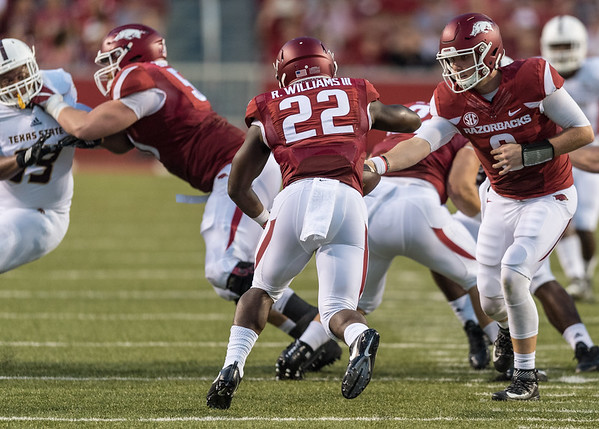 Arkansas Razorbacks quarterback Austin Allen (8) hands the ball off to Rawleigh Williams III during a football game between the Arkansas Razorbacks and the Texas State Bobcats on Saturday, September 17, 2016.  (Alan Jamison, Nate Allen Sports Service)