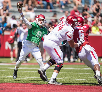 Colton Jackson protects Austin Allen during the Arkansas Razorback Spring Football Game on 4/23/2016.   (Alan Jamison, Nate Allen Sports Service)