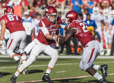 Arkansas Razorbacks quarterback Austin Allen (8) hands off to Rawleigh Williams III during a football game between the Arkansas Razorbacks and the Louisiana Tech Bulldogs on Saturday, September 3, 2016.  (Alan Jamison, Nate Allen Sports Service)