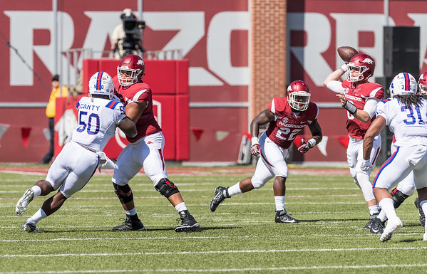 Arkansas Razorbacks offensive lineman Colton Jackson (74) protects Austin Allen during a football game between the Arkansas Razorbacks and the Louisiana Tech Bulldogs on Saturday, September 3, 2016.  (Alan Jamison, Nate Allen Sports Service)