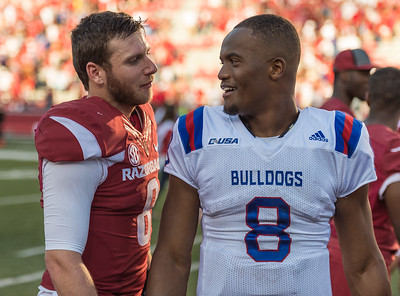 Arkansas Razorbacks quarterback Austin Allen (8) meets with his opponent Louisiana Tech Bulldogs defensive back DaMarion King (8) after the football game between the Arkansas Razorbacks and the Louisiana Tech Bulldogs on Saturday, September 3, 2016.  (Alan Jamison, Nate Allen Sports Service)