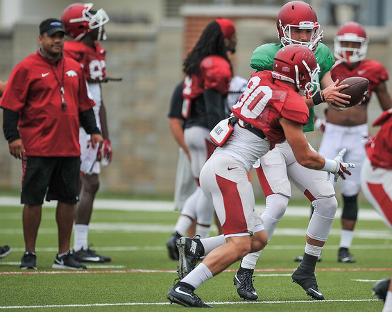 Brandon Allen hands off to Drew Morgan at the Razorback football practice on Tuesday, August 18, 2015 at the Fred W. Smith Football Center in Fayetteville, Arkansas.   (Alan Jamison, Nate Allen Sports Service).