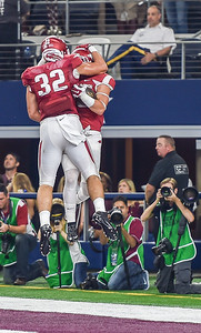 Hunter Henry (32) celebrates with Drew Morgan (80) after Morgan's receiving touchdown during the Southwest Classic game between the Arkansas Razorbacks and the Texas A&M Aggies at AT&T Stadium in Arlington, Texas.   (Alan Jamison, Nate Allen Sports Service)