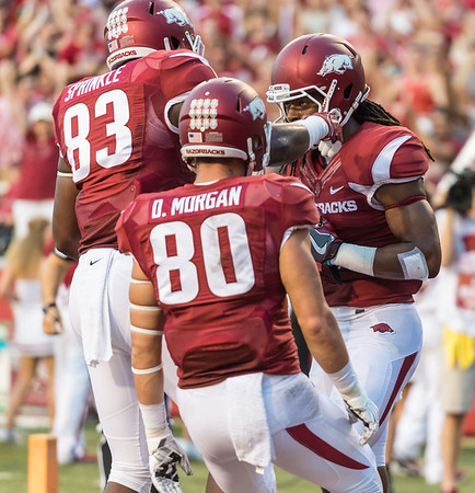 Arkansas Razorbacks tight end Jeremy Sprinkle (83) and Drew Morgan (80) celebrate Keon Hatcher's touchdown during a football game between the Arkansas Razorbacks and the Texas State Bobcats on Saturday, September 17, 2016.  (Alan Jamison, Nate Allen Sports Service)