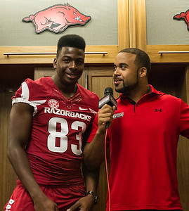 Jeremy Sprinkle (83) and Hunter Henry (84) meet with media during the Razorback Media Day on Sunday, August 9, 2015 at the Fred W. Smith Football Center in Fayetteville, Arkansas.   (Alan Jamison, Nate Allen Sports Service).