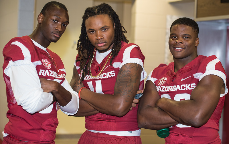 Dominique Reed, Will Gragg, and Dre Greenlaw at Razorback Media Day on Sunday, August 9, 2015 at the Fred W. Smith Football Center in Fayetteville, Arkansas.   (Alan Jamison, Nate Allen Sports Service).