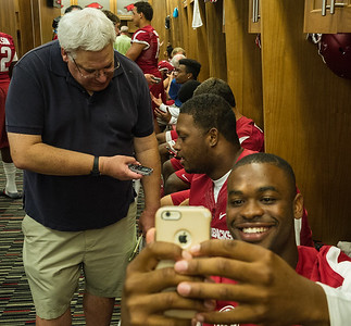 DJ Dean snaps a selfie as Taiwan Johnson is interviewed by media at the Razorback Media Day on Sunday, August 9, 2015 at the Fred W. Smith Football Center in Fayetteville, Arkansas.   (Alan Jamison, Nate Allen Sports Service).