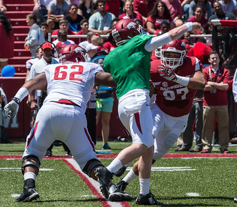 Offensive Lineman Johnny Gibson attempts to block Defensive End Tevin Beanum during the Arkansas Red-White Spring Football Game on Saturday, April 25, 2015 in Fayetteville, Arkansas at Donald W. Reynolds Razorback Stadium.  The Red team won 62-18 in front of an official attendance of 41,220 fans.   (Alan Jamison, Nate Allen Sports Service)