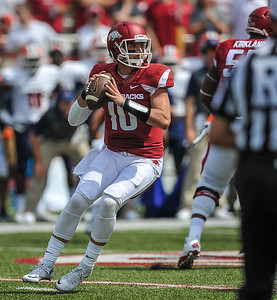 Arkansas Razorbacks quarterback Brandon Allen (10) prepares to pass during a football game between the Arkansas Razorbacks and the UTEP Miners on Saturday, September 5, 2015 at the  Donald W. Reynolds Razorback Stadium in Fayetteville, Arkansas.  Arkansas won the game 48-13.  (Alan Jamison, Nate Allen Sports Service).