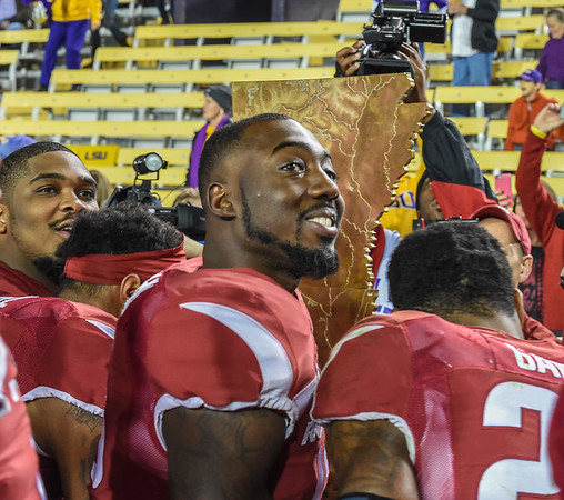 Arkansas Razorbacks defensive back Davyon (Sleepy) McKinney (13) and teammates prepare to take The  Golden Boot for the second year in a row during a football game between Arkansas and LSU on November 14, 2015.    (Alan Jamison, Nate Allen Sports Service)