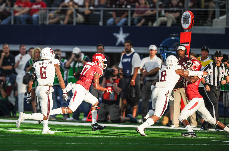 Arkansas Razorbacks wide receiver Jojo Robinson (17) heads for a first down during the Southwest Classic game between the Arkansas Razorbacks and the Texas A&M Aggies at AT&T Stadium in Arlington, Texas.   (Alan Jamison, Nate Allen Sports Service)