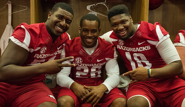 T.J. Smith (54), Rohan Gaines (26), and Derrick Graham (18) at the Razorback Media Day on Sunday, August 9, 2015 at the Fred W. Smith Football Center in Fayetteville, Arkansas.   (Alan Jamison, Nate Allen Sports Service).