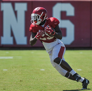 Denzell Evans carries during the Razorback football practice on Thursday, August 20, 2015 at the Fred W. Smith Football Center in Fayetteville, Arkansas.   (Alan Jamison, Nate Allen Sports Service).