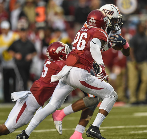 Rohan Gaines assists with a tackle during a football game between the Arkansas Razorbacks and the UT Martin Skyhawks in Reynolds Razorback Stadium on October 31, 2015.   Arkansas led 35-14 at the half (Alan Jamison, Nate Allen Sports Service)