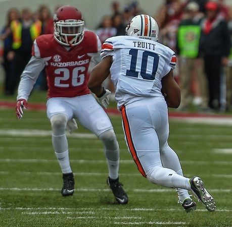 Rohan Gaines (26) prepares to tackle Auburn wide receiver Stanton Truitt (10) during the football game between the Arkansas Razorbacks and the Auburn Tigers at Reynolds Razorback Stadium in Fayetteville, Arkansas.  (Alan Jamison, Nate Allen Sports Service)