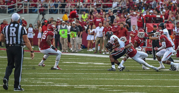 Arkansas safety Rohan Gaines (26) with a tackle during a football game between the Arkansas Razorbacks and the Texas Tech Red Raiders at Reynolds Razorback Stadium at the University of Arkansas in Fayetteville, Arkansas.   Texas Tech won 35-24.  (Alan Jamison, Nate Allen Sports Service)