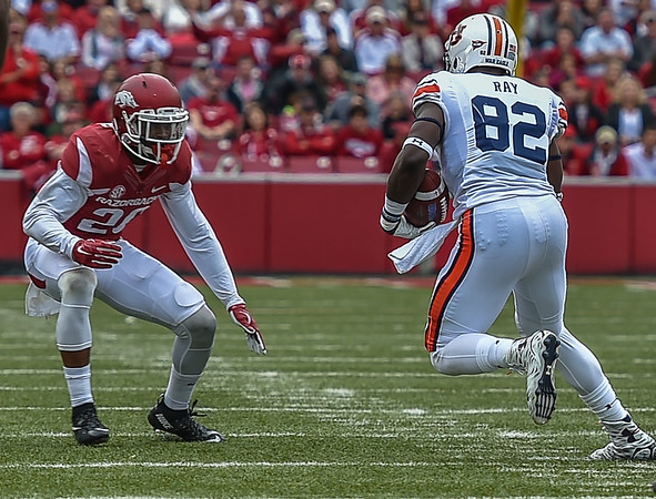 Rohan Gaines (26) prepares to tackle Auburn wide receiver Melvin Ray (82) during the football game between the Arkansas Razorbacks and the Auburn Tigers at Reynolds Razorback Stadium in Fayetteville, Arkansas.  Arkansas won 54-46 in four overtimes.  (Alan Jamison, Nate Allen Sports Service)