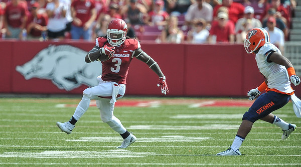 Arkansas Razorbacks running back Alex Collins (3) runs with the ball during a football game between the Arkansas Razorbacks and the UTEP Miners on Saturday, September 5, 2015 at the  Donald W. Reynolds Razorback Stadium in Fayetteville, Arkansas.  Arkansas won the game 48-13.  (Alan Jamison, Nate Allen Sports Service).