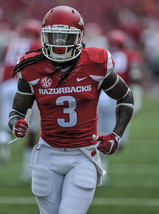 Alex Collins warms up before a football game between the Arkansas Razorbacks and the UTEP Miners on Saturday, September 5, 2015 at the  Donald W. Reynolds Razorback Stadium in Fayetteville, Arkansas.  Arkansas won the game 48-13.  (Alan Jamison, Nate Allen Sports Service).