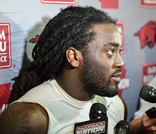 Alex Collins meets with media after the Razorback football practice on Thursday, August 20, 2015 at the Fred W. Smith Football Center in Fayetteville, Arkansas.   (Alan Jamison, Nate Allen Sports Service).