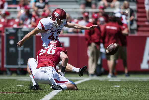 Matt Emrich holds the ball for a Field Goal Attempt by Lane Saling during the Arkansas Red-White Spring Football Game on Saturday, April 25, 2015 in Fayetteville, Arkansas at Donald W. Reynolds Razorback Stadium.  The Red team won 62-18 in front of an official attendance of 41,220 fans.   (Alan Jamison, Nate Allen Sports Service)