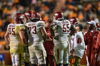 Coach Sam Pittman talks to Mitch Smothers (65), Sebastian Tretola (73) and Denver Kirkland (55) during a football game between the Arkansas Razorbacks and the Tennessee Volunteers at Neyland Stadium in Knoxville, Tennesee.     Arkansas won 24-20.  (Alan Jamison, Nate Allen Sports Service)