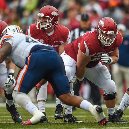 Mitch Smothers prepares to snap the ball during a football game between the Arkansas Razorbacks and the UT Martin Skyhawks in Reynolds Razorback Stadium on October 31, 2015.   Arkansas won 63-28.  (Alan Jamison, Nate Allen Sports Service)