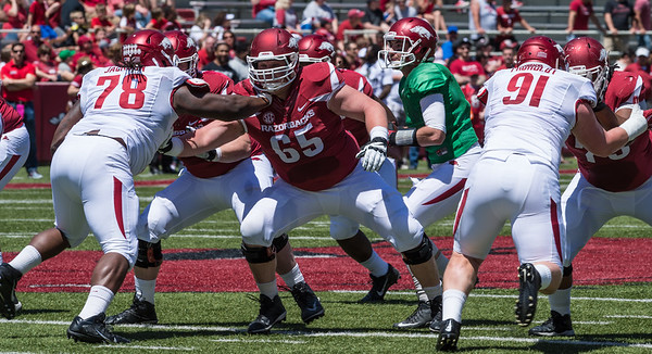 Senior Offensive Lineman MItch Smothers blocks Sophomore Defensive Tackle Bijhon Jackson during the Arkansas Red-White Spring Football Game on Saturday, April 25, 2015 in Fayetteville, Arkansas at Donald W. Reynolds Razorback Stadium.  The Red team won 62-18 in front of an official attendance of 41,220 fans.   (Alan Jamison, Nate Allen Sports Service)