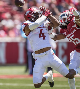 Willie Sykes breaks up a pass intended for Keon Hatcher during the Arkansas Razorback Spring Football Game on 4/23/2016.   (Alan Jamison, Nate Allen Sports Service)