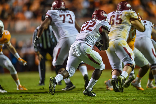 Rawleigh Williams (22) carries behind the blocking of Sebastian Tretola (73) and Mitch Smothers (65) during a football game between the Arkansas Razorbacks and the Tennessee Volunteers at Neyland Stadium in Knoxville, Tennesee.     Arkansas won 24-20.  (Alan Jamison, Nate Allen Sports Service)