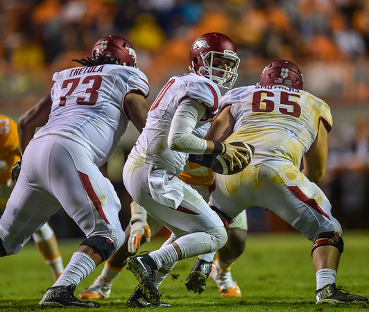 Sebastian Tretola (73) and Mitch Smothers (65) protect Brandon Allen during a football game between the Arkansas Razorbacks and the Tennessee Volunteers at Neyland Stadium in Knoxville, Tennesee.     Arkansas won 24-20.  (Alan Jamison, Nate Allen Sports Service)