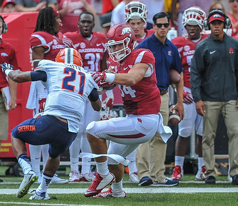 Arkansas Razorbacks tight end Hunter Henry (84) evades a tackle during a football game between the Arkansas Razorbacks and the UTEP Miners on Saturday, September 5, 2015 at the  Donald W. Reynolds Razorback Stadium in Fayetteville, Arkansas.  Arkansas won the game 48-13.  (Alan Jamison, Nate Allen Sports Service).