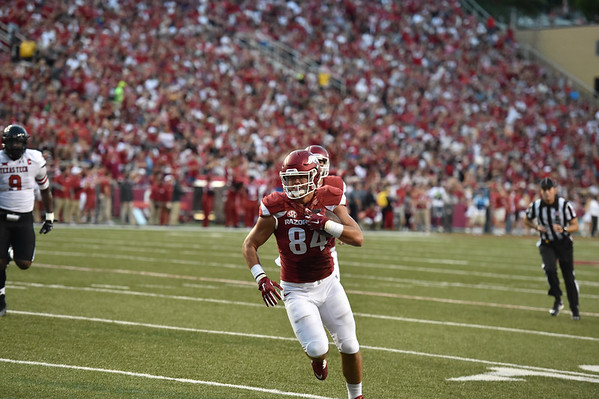 Hunter Henry runs into the end zone for a touchdown during the first half of a football game between the Arkansas Razorbacks and the Texas Tech Red Raiders at Reynolds Razorback Stadium at the University of Arkansas in Fayetteville, Arkansas.   (Alan Jamison, Nate Allen Sports Service)