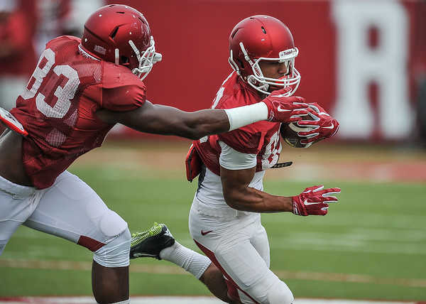 Jeremy Sprinkle prepares to tackle Jovante Siglar at the Razorback football practice on Tuesday, August 18, 2015 at the Fred W. Smith Football Center in Fayetteville, Arkansas.   (Alan Jamison, Nate Allen Sports Service).