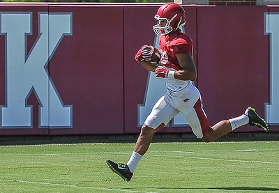 Jovante Siglar crosses the goal line during the Razorback football practice on Thursday, August 20, 2015 at the Fred W. Smith Football Center in Fayetteville, Arkansas.   (Alan Jamison, Nate Allen Sports Service).
