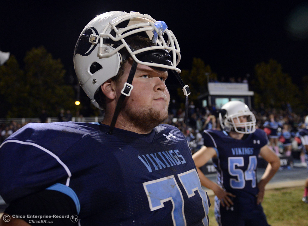 . Pleasant Valley High\'s #77 Tyler Stimac looks on against Foothill High in the second quarter of their football game at PVHS Asgard Yard Friday, October 11, 2013 in Chico, Calif.  (Jason Halley/Chico Enterprise-Record)