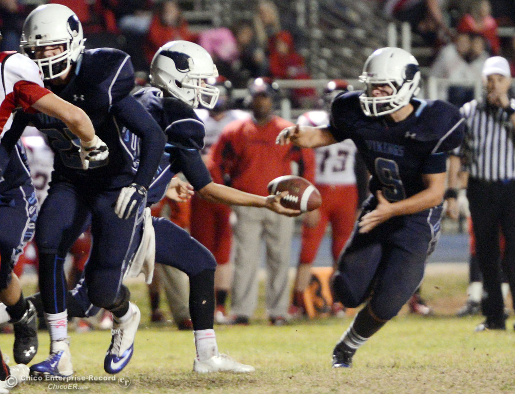 . Pleasant Valley High\'s #12 Trent Darms (left) hands off to #9 Houston McGowan (right) against Foothill High in the fourth quarter of their football game at PVHS Asgard Yard Friday, October 11, 2013 in Chico, Calif.  (Jason Halley/Chico Enterprise-Record)