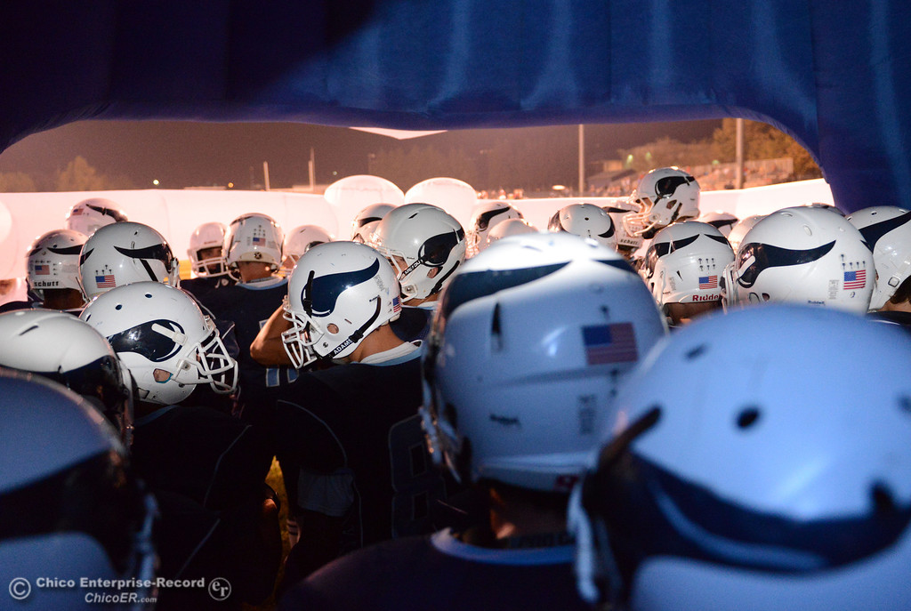 . Pleasant Valley High\'s team prepares to take the field against Foothill High in the first quarter of their football game at PVHS Asgard Yard Friday, October 11, 2013 in Chico, Calif.  (Jason Halley/Chico Enterprise-Record)