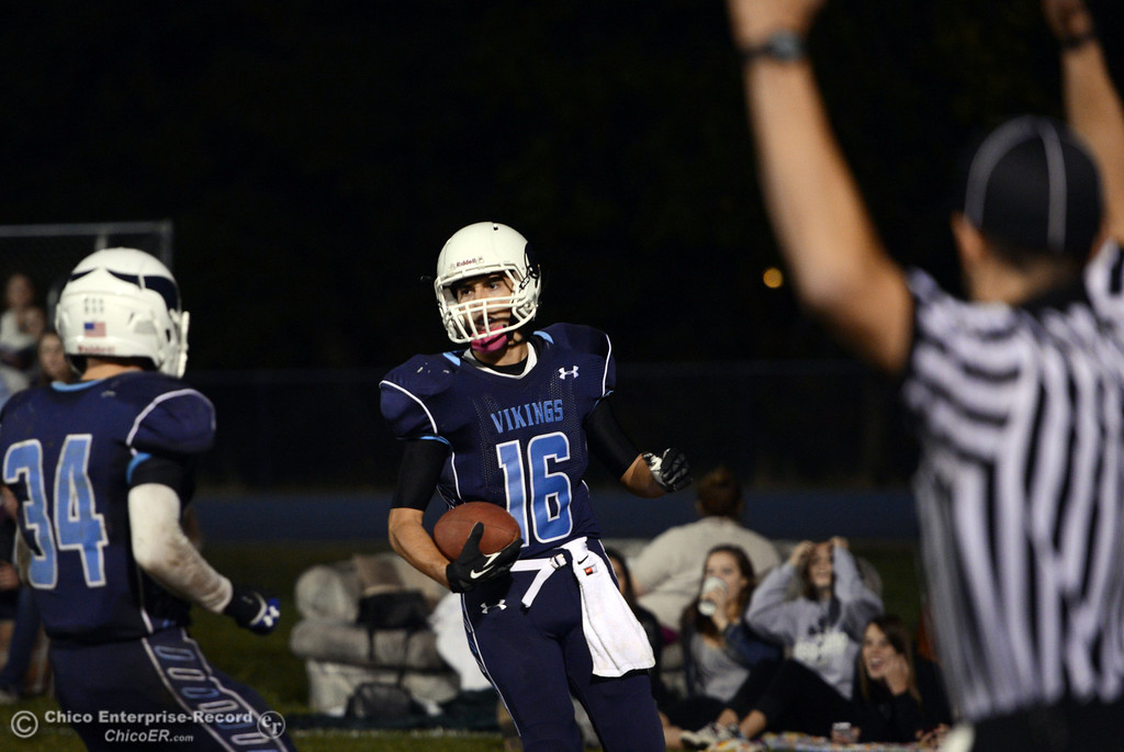 . Pleasant Valley High\'s #16 Trey Rosenbalm (right) completes a catch for a touchdown against Foothill High in the third quarter of their football game at PVHS Asgard Yard Friday, October 11, 2013 in Chico, Calif.  (Jason Halley/Chico Enterprise-Record)