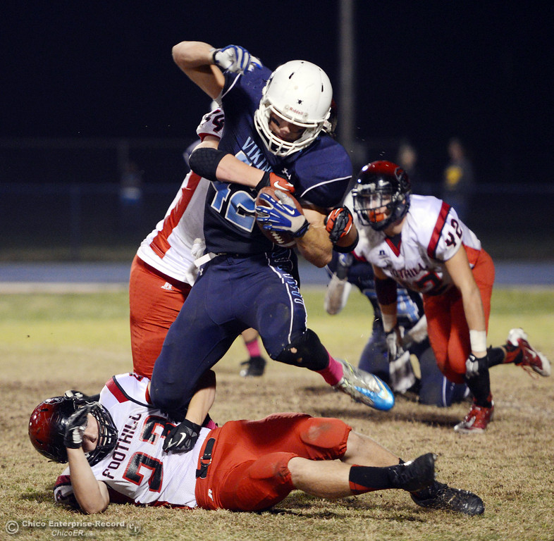 . Pleasant Valley High\'s #42 Chad Olsen (center) is tackled against Foothill High\'s #44 Drew Faircloth (left) and #23 Zac Thompson (bottom) in the second quarter of their football game at PVHS Asgard Yard Friday, October 11, 2013 in Chico, Calif.  (Jason Halley/Chico Enterprise-Record)