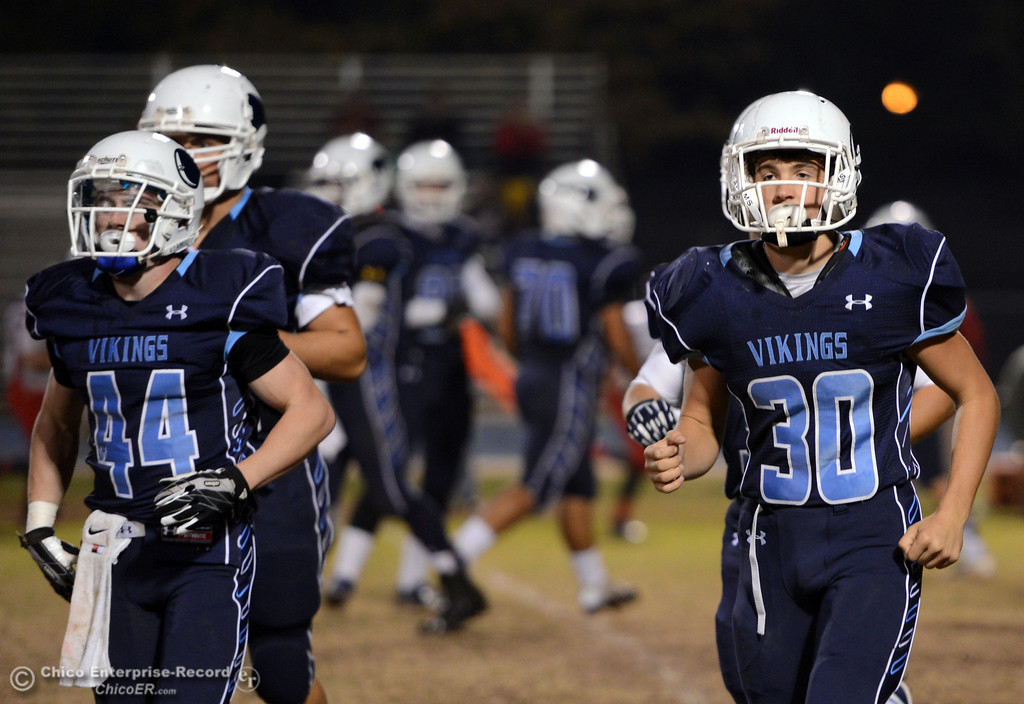. Pleasant Valley High\'s #44 Cyland Leitner (left) and #30 Connor Melton (right) come off the field against Foothill High in the first quarter of their football game at PVHS Asgard Yard Friday, October 11, 2013 in Chico, Calif.  (Jason Halley/Chico Enterprise-Record)