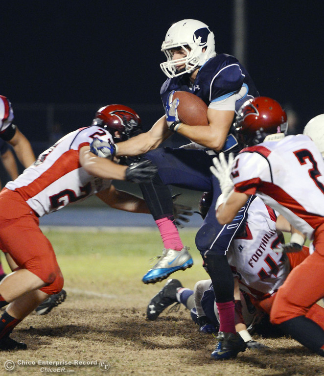 . Pleasant Valley High\'s #42 Chad Olsen (center) is tackled against Foothill High\'s #23 Zac Thompson (left) #42 Tyler Duclos (back) and #2 Chandler Roe (right) in the second quarter of their football game at PVHS Asgard Yard Friday, October 11, 2013 in Chico, Calif.  (Jason Halley/Chico Enterprise-Record)