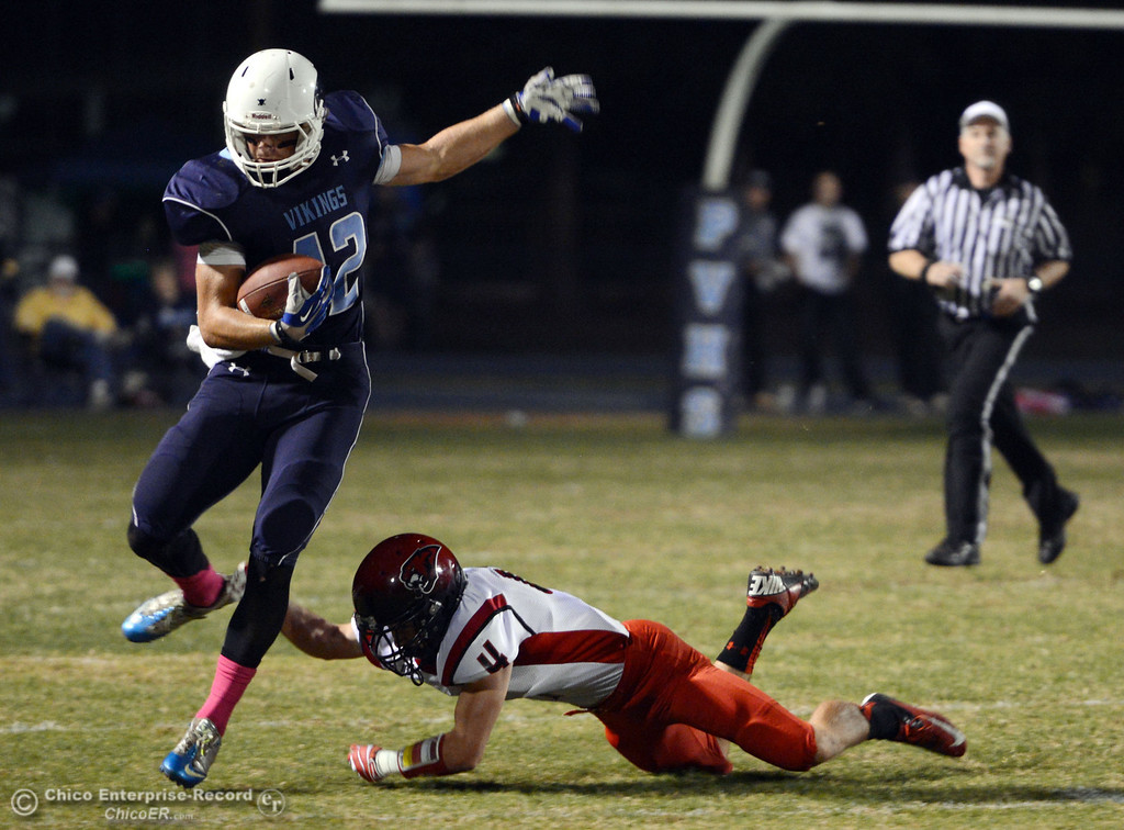 . Pleasant Valley High\'s #42 Chad Olsen (left) breaks a tackle against Foothill High\'s #4 Luke Kelly (right) in the first quarter of their football game at PVHS Asgard Yard Friday, October 11, 2013 in Chico, Calif.  (Jason Halley/Chico Enterprise-Record)