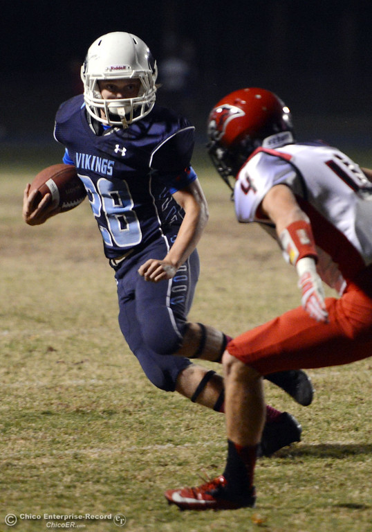 . Pleasant Valley High\'s #28 Dylan Batie (left) rushes against Foothill High\'s #4 Luke Kelly (right) in the first quarter of their football game at PVHS Asgard Yard Friday, October 11, 2013 in Chico, Calif.  (Jason Halley/Chico Enterprise-Record)