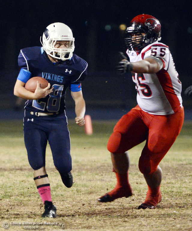 . Pleasant Valley High\'s #28 Dylan Batie (left) rushes against Foothill High\'s #55 Willie Mitchell (right) in the first quarter of their football game at PVHS Asgard Yard Friday, October 11, 2013 in Chico, Calif.  (Jason Halley/Chico Enterprise-Record)