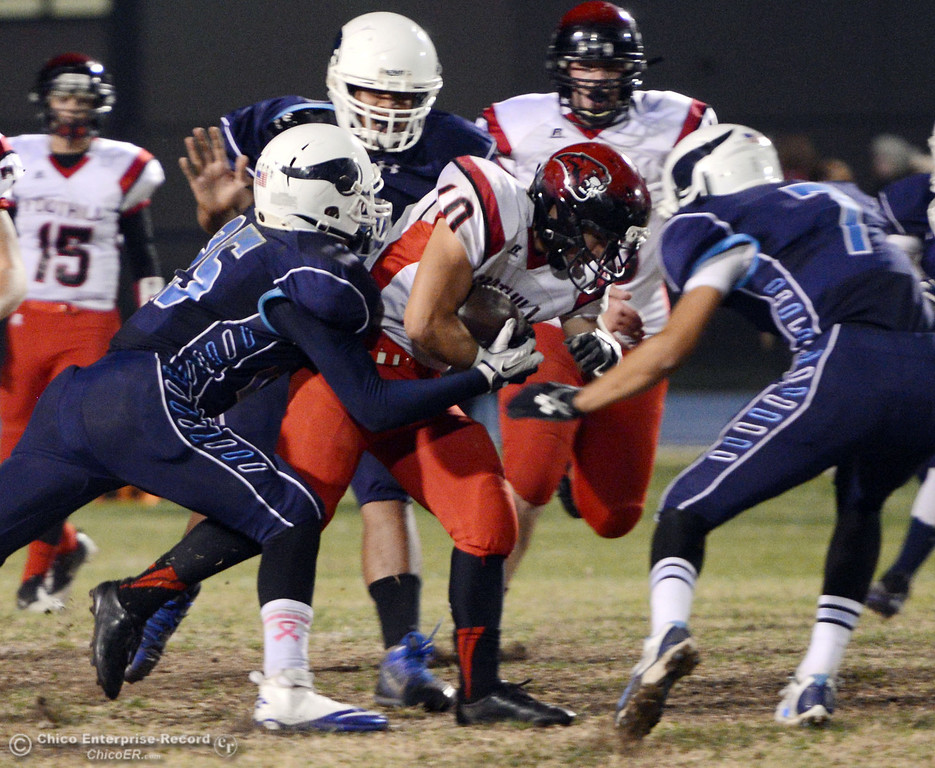 . Pleasant Valley High\'s #25 Ryan Steindorf, #78 Alex Marquez, and #7 Zen Ferguson (left to right) tackle against Foothill High\'s #10 Blake Burnett (center) in the second quarter of their football game at PVHS Asgard Yard Friday, October 11, 2013 in Chico, Calif.  (Jason Halley/Chico Enterprise-Record)
