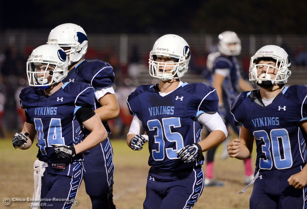 . Pleasant Valley High\'s #44 Cyland Leitner (left) #35 Benjamin Whitmore (center) and #30 Connor Melton (right) come off the field against Foothill High in the first quarter of their football game at PVHS Asgard Yard Friday, October 11, 2013 in Chico, Calif.  (Jason Halley/Chico Enterprise-Record)